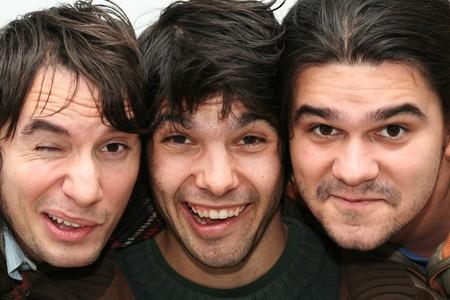 Tree young men funny close-up portraits