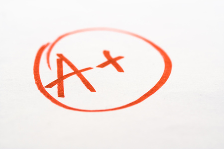 School exam grade A+ mark on paper photo