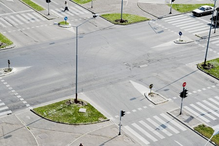 Street crossroad from above. Traffic lights and city traffic