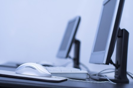 Computer classroom. Two computers in line in school classroom Stock Photo