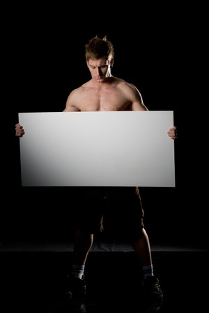 confident man holding a blank board. Advertising concept photo