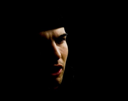 subversive: Man Face from the shadow. Face in the darkness