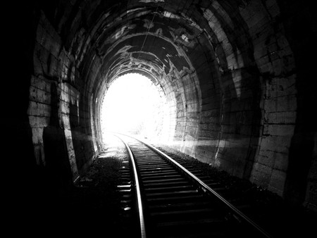 Light on the end of railway tunnel.  photo