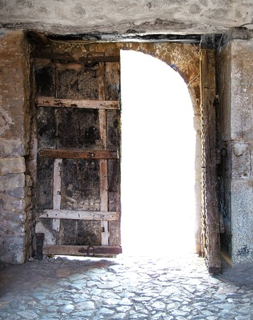 overexposed: Old wooden door and overexposed lignt entering