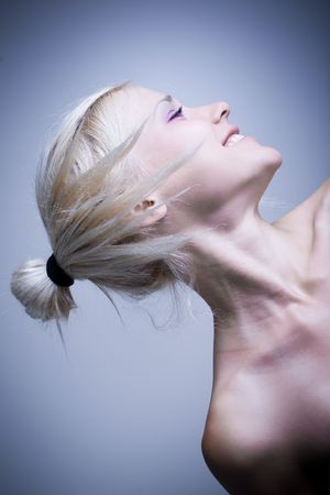 Beauty portrait of beauty with funky blond hairstyle isolated photo