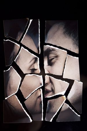 hate: Ripped photograph into pieces concept.  Broken love relationship Stock Photo