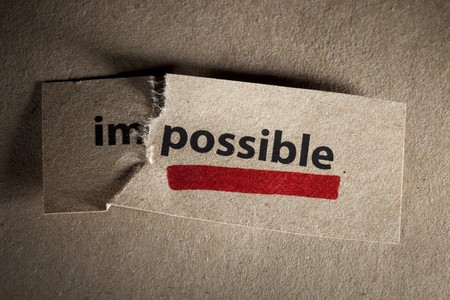 expertise concept: Word impossible transformed into possible. Motivation philosophy concept