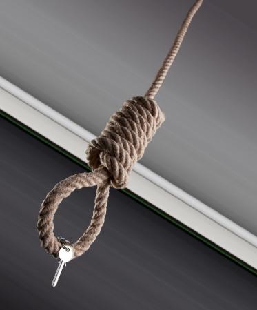 House keys haging on a hangman noose