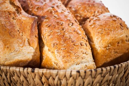 Loaf of bread with sunflower seeds in a basket  Shallow DOF