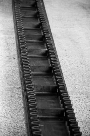 cinta transportadora: Cinta transportadora de goma DOF Foto de archivo