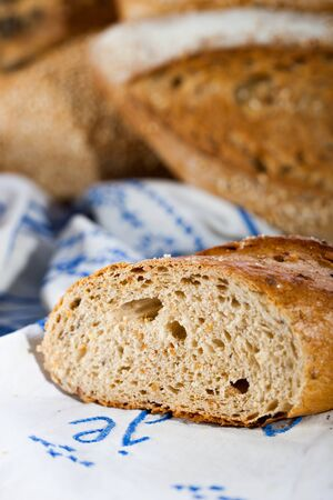 Baked bread sliced, detail  Other breads in background blur Stock Photo