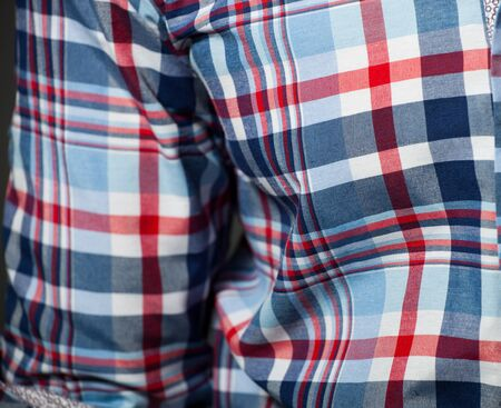 Checked pattern on a cotton shirt   Shallow DOF, focused on right Stock Photo - 17575216