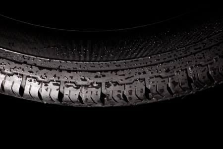 Isolated winter tire with water drops  Aquaplaning concept of traffic safety Stock Photo - 17575355
