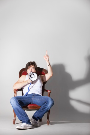 Man sitting in a chair announcing  the news  Large copyspace  Original size 5760 x 3840