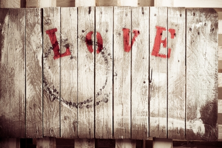 Wooden love dyed wooden plate in retro style photo