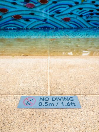 Warning sign showing the depth of the swimming pool and not allow to jump or dive in this area.