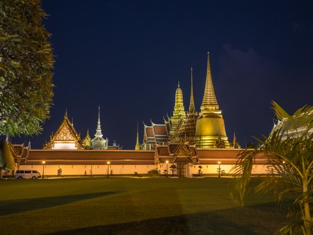 Night view of the temple of the emerald Buddha with dark blue background