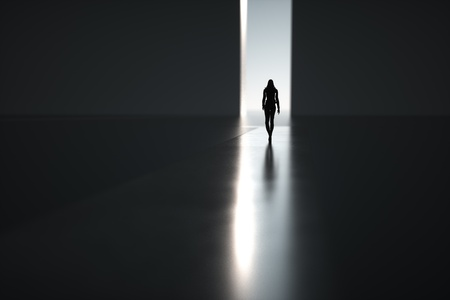 Silhouette of woman goes on abstract way through light.