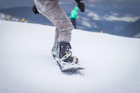 Dragobrat, Ukraine - December 26, 2018: Girls and boys ski ingly ski and snowboard