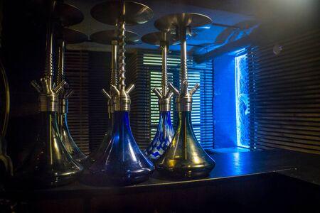 Few hookahs stand in a bar Фото со стока