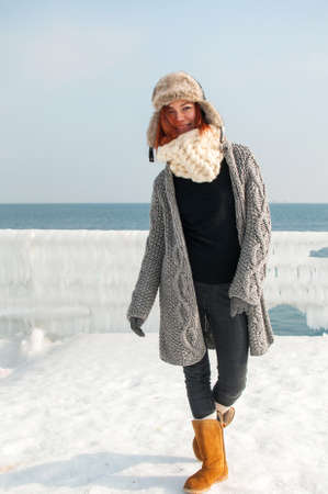 scarf beach: portrait of young attractive woman with scarf on winter beach.