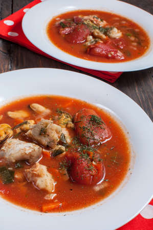 flavorsome: Delicious Mediterranean style tomato seafood soup with a variety of mixed seafood.