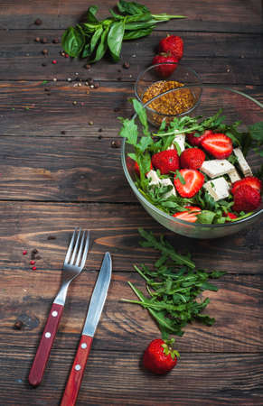 Salad of lettuce, arugula, strawberries feta cheese