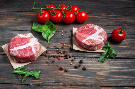 uk cuisine: Home HandMade Minced Beef burgers on wooden table. Top Stock Photo