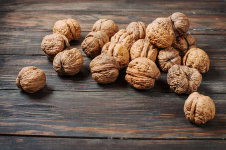 nutshells: Closeup walnuts on wooden dark table. Selective focus Stock Photo