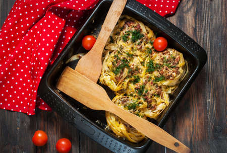 forcemeat: Baked rolled pasta with forcemeat and cheesy tomato sauce