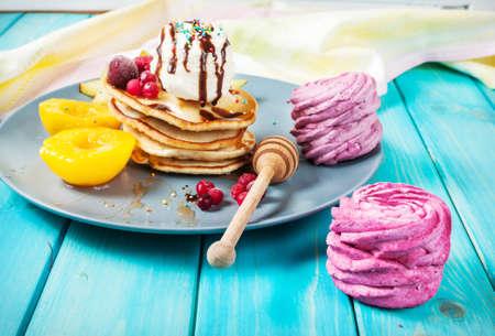 Pancakes with Vanilla Ice Cream on blue wood plate