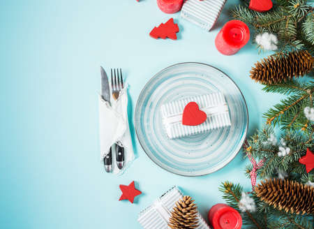 grunge cutlery: Christmas table setting on blue background with fir tree and decoration. Top view and copy space