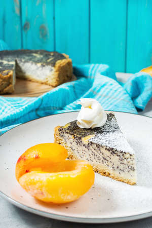 Pieces of delicious poppy seed cheesecake and peach.