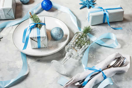Beautiful Christmas table setting with decorations. Preparation for christmas dinner. Banco de Imagens