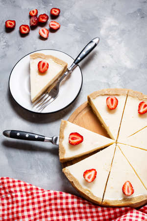 Homemade cheesecake with fresh strawberries sliced on concrete background Stok Fotoğraf