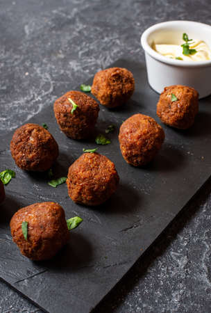fresh vegetarian falafel balls with sauce on black stone background Stock fotó