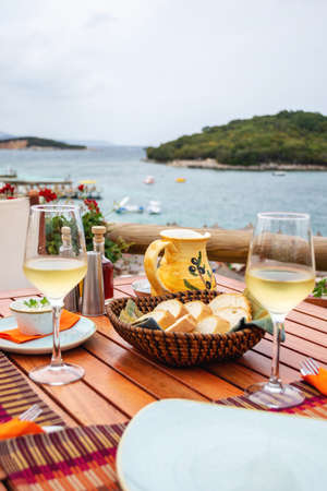 Restaurant with served table in seafront of Ionian sea on Ksamil