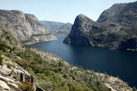 central california: The manmade Hetch Hetchy Reservoir in Yosemite National Park provides water to the city of San Francisco through a gravity-fed pipe system that spans California s vast central valley  Stock Photo