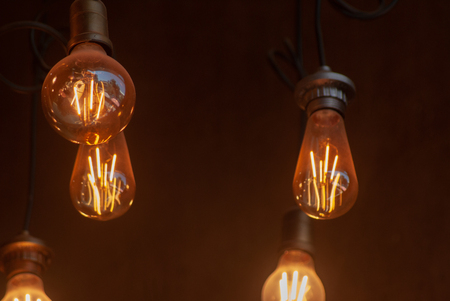 Retro light bulbs hanging with blurry background