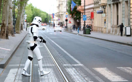stormtrooper: Guy dressed as Stormtrooper from movie crossing the street Editorial