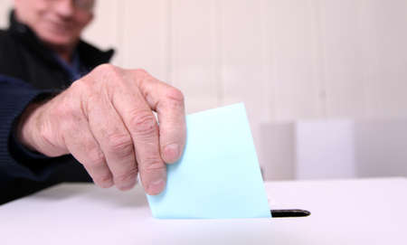 voting: Older man voting at elections