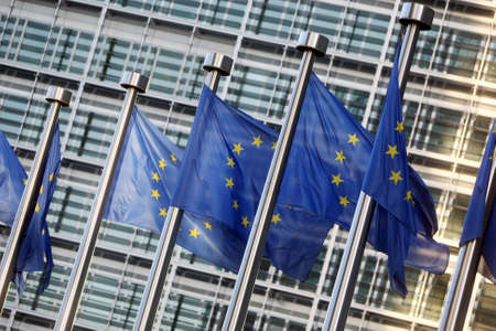 commission: Flags of European Union in front of European Commission Stock Photo