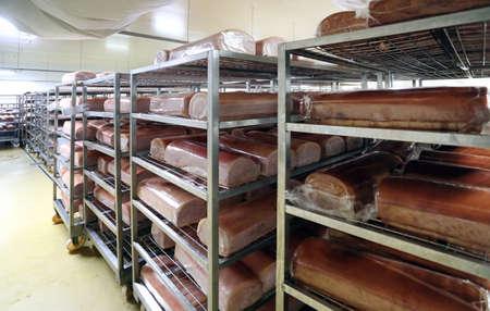 Piaces of meat, pork meat in big fridge