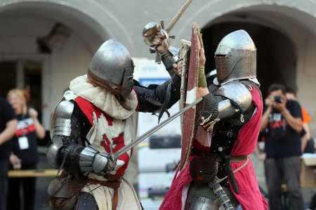 Medieval battle with swords in the armor suit
