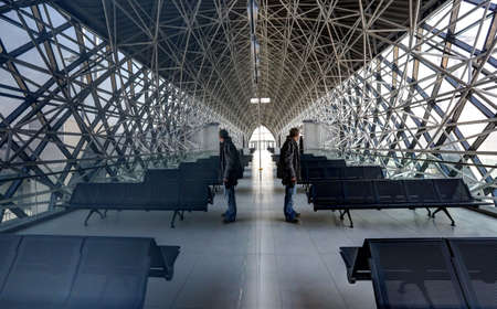 Reflection in glass shows a man standing in the new Terminal of Franjo Tudjman airport in Zagreb, Croatia, 16 March 2017. Publikacyjne
