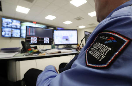Security officer sitting in control room on the new terminal of Franjo Tudjman airport in Zagreb, Croatia, 16 March 2017