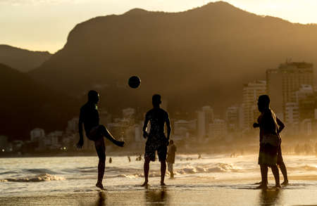 Boys playing with ball at Arpador, Ipanema beach in Rio de Janeiro, Brazil Zdjęcie Seryjne