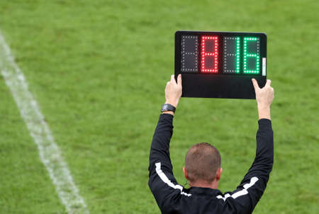 The referee shows the number display announcing the change of players during the soccer match Zdjęcie Seryjne