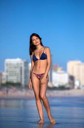 Beautiful girl in bikini on Leblon beach in Rio de Janeiro