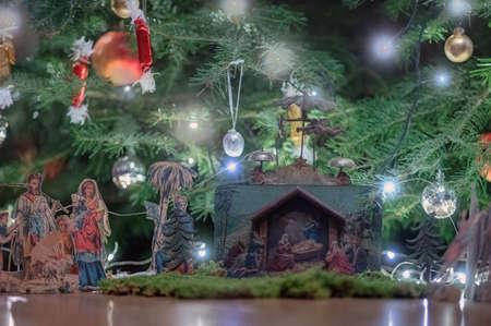 Little Christmas nursery under decorated Christmas tree